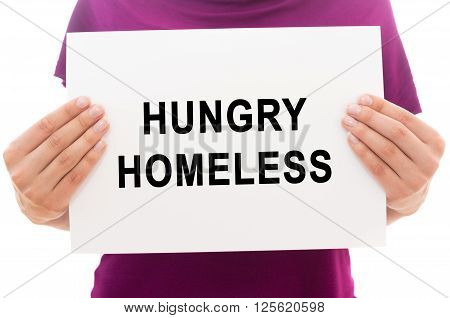 Girl holding white paper sheet with text Hungry homeless