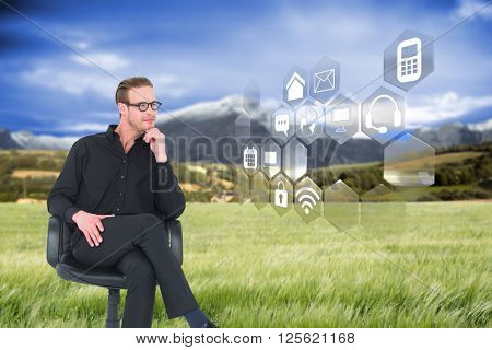 Thoughtful businessman sitting on a swivel chair against scenic backdrop