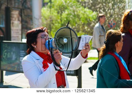 Volgograd, Russia - May 1 2011: Demonstrator with a megaphone in the May day demonstration in Volgograd