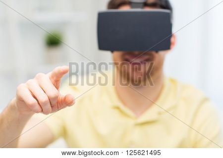 3d technology, virtual reality, entertainment and people concept - close up of happy young man with virtual reality headset or 3d glasses playing game at home