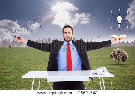 Unsmiling businessman sitting with arms outstretched against cityscape on the horizon