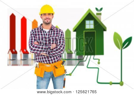 Manual worker standing arms crossed against clean energy house
