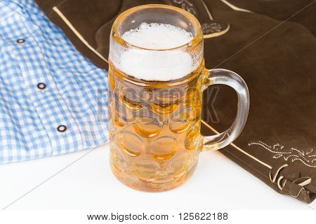 traditional Bavarian pants deerskin and a mug of beer