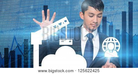 Unsmiling businessman holding and pointing against blue data