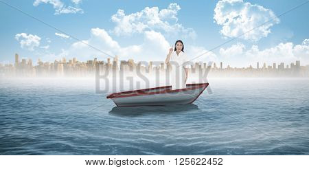 Smart dark haired model with classy dress posing against small boat in the sea with city on horizon