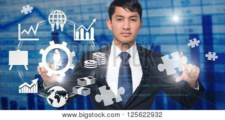Unsmiling businessman holding against blue data