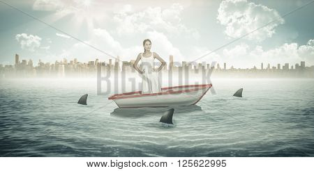 Pensive brunette looking away against sharks circling a small boat in the sea