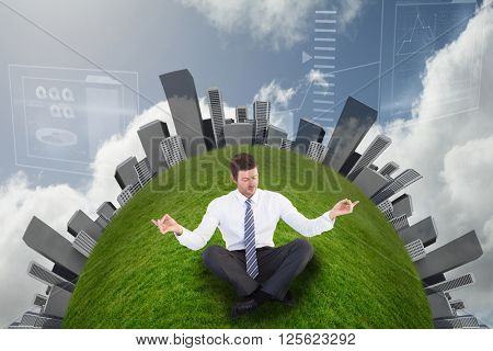 Businessman in suit sitting in lotus pose against bright blue sky with clouds