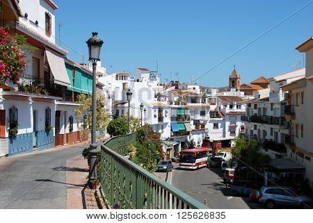TORROX, SPAIN - JULY 1, 2008 - View along the main shopping street with the church to the rear Torrox Malaga Province Andalucia Spain Western Europe, July 1, 2008.