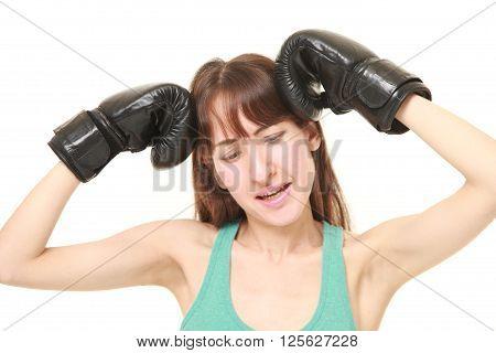 studio shot of Defeated female boxer on white background