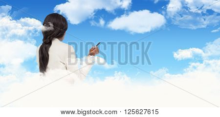 Thinking businesswoman against blue sky