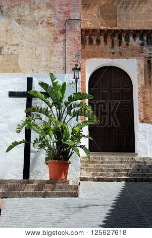 Church doorway and cross in the centre of the village Torrox Malaga Province Andalucia Spain Western Europe.