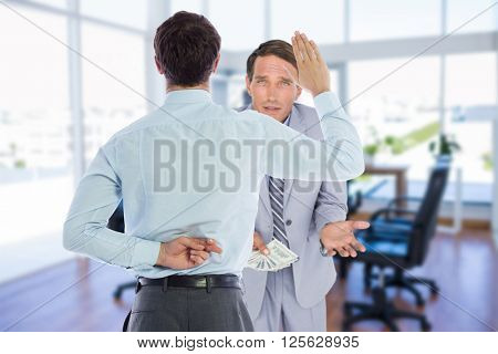 Businessman crossing fingers behind his back against board room