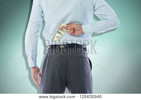 Businessman crossing fingers behind his back against blue background