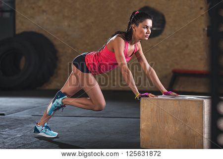 woman doing workout in  the gym, climber exercise full length