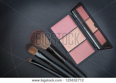 Dark Tone Selective Focus On Beautiful Peachy Cheek Blusher Kit
