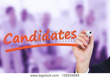 Businessman writing with marker against team of cool business people posing together