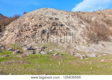 big rocks falling down from the high hill