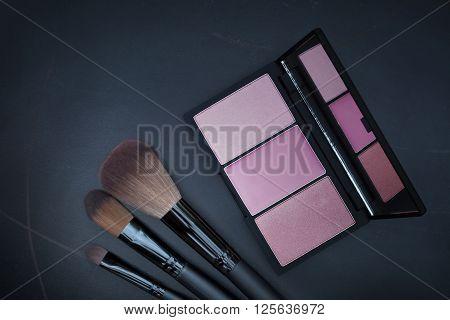 Dark Tone Selective Focus On Beautiful Purple Cheek Blusher Kit