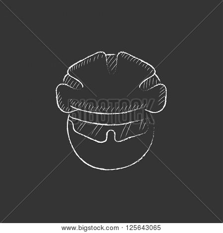 Man in bicycle helmet and glasses. Drawn in chalk icon.
