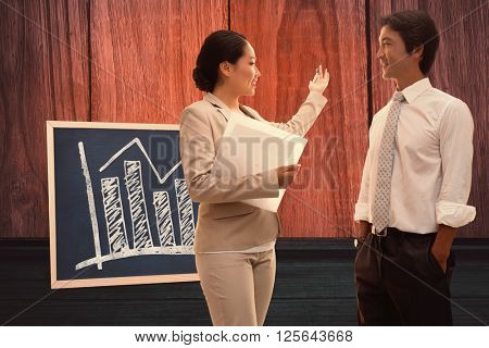 Estate agent speaking with potential buyer against black board on a table