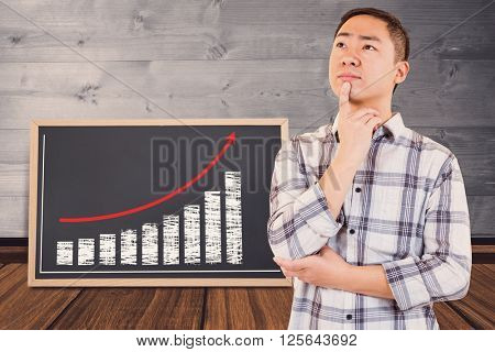 Thoughtful man looking away against full face black board