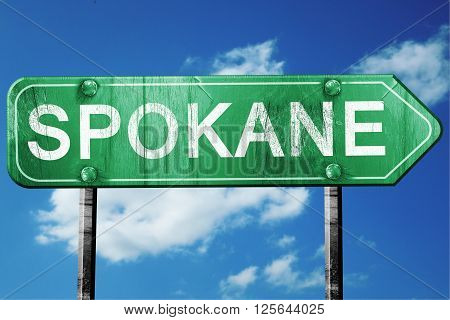 spokane road sign on a blue sky background