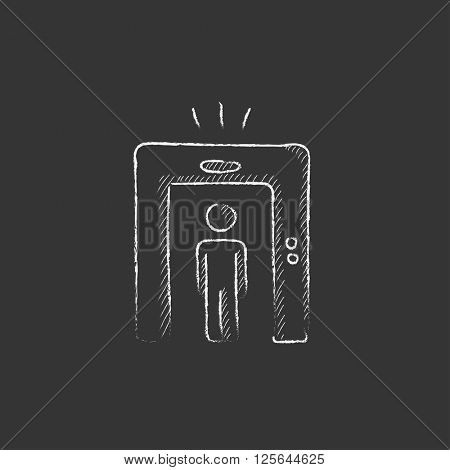 Man going through metal detector gate. Drawn in chalk icon.