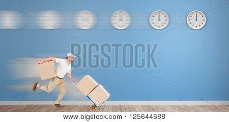 Delivery man with trolley of boxes running in front of clocks on a blue room
