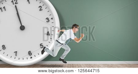 Geeky happy businessman running mid air in front of a clock