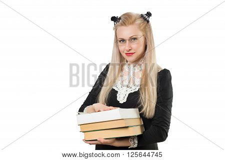 Clever blonde girl with glasses and pile of books - isolated on white