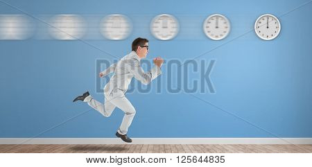 Geeky happy businessman running mid air on a blue room