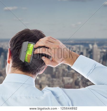 Businessman scratching his head against new york