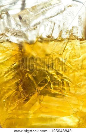 Close up glass of whiskey and ice