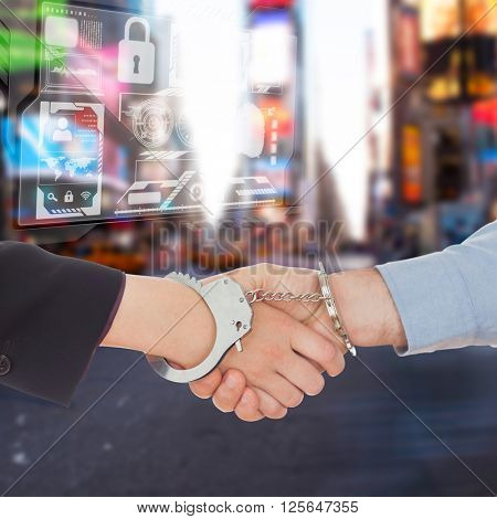 Business people in handcuffs shaking hands against blurry new york street