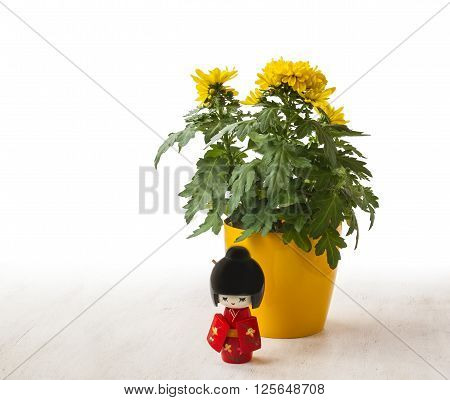 The concept of a Japanese holiday chrysanthemums ninth of the ninth lunar month of the traditional Japanese doll Kokeshi (mass production)