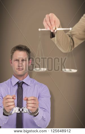 Young woman holding scales of justice and a gavel against grey background with vignette