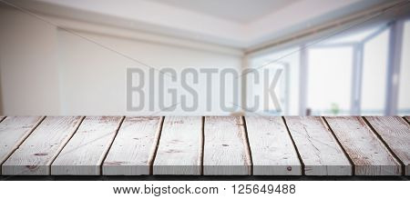 Cute couple taking a break from unpacking against wooden table