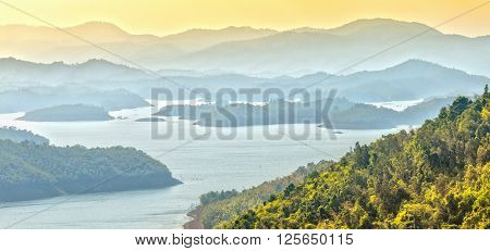 Ta Dung beautiful lake while in the afternoon sky yellow cover, beneath mountains, misty island beautiful successive peace.