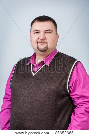 Businessman with overweight smiling on the gray background