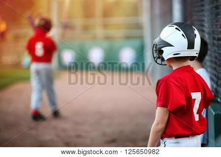 Youth Baseball player waiting on deck in batting line up, focus on boys shoulder