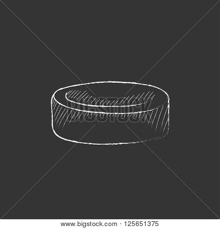 Hockey puck. Drawn in chalk icon.