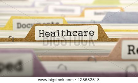 Healthcare Concept. Colored Document Folders Sorted for Catalog. Closeup View. Selective Focus. 3D Render.