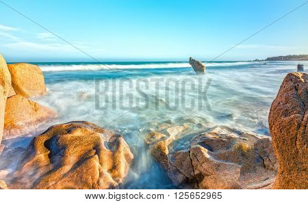 Lonely rock ocean waves with beautiful shapes floating lies  beach before waves like clouds in the afternoon sun beautiful to watch and resort in central Vietnam coast.