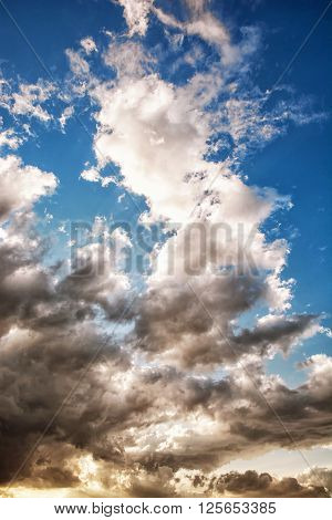 Dramatic stormy sky. Natural scene. Dark and light tones. Vertical composition.