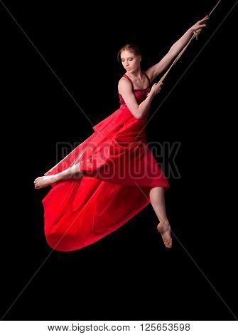 Oung Woman Gymnast On Rope On Black Background