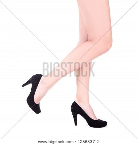 Slim Female Legs In Black Shoes Isolated On White