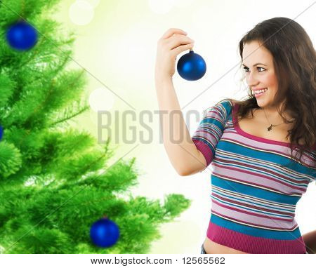 Beautiful Girl  decorating a Christmas tree