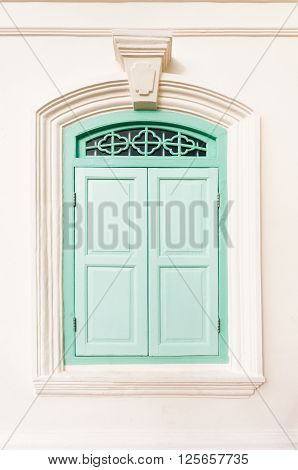 Old retro green sino portuguese style window