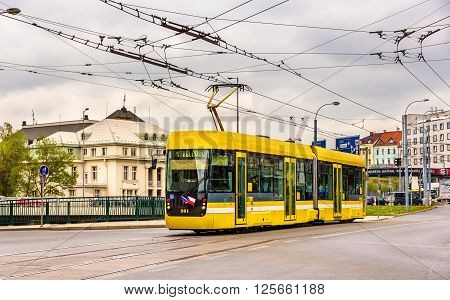 Plzen, Czech Republic - May 3, 2014: VarioLF2-2 IN tramway passes in the city center. Tram network in Plzen is operating since 1899